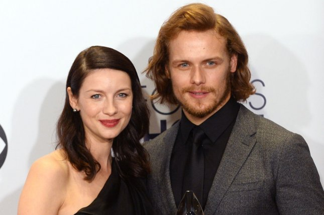 Sam Heughan (R), pictured with Caitriona Balfe, dedicated a sweet and funny post to the actress on her birthday. File Photo by Jim Ruymen/UPI