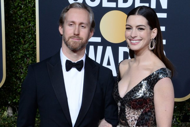 Anne Hathaway (R), pictured with Adam Shulman, explained why she's given up alcohol until her son turns 18. File Photo by Jim Ruymen/UPI