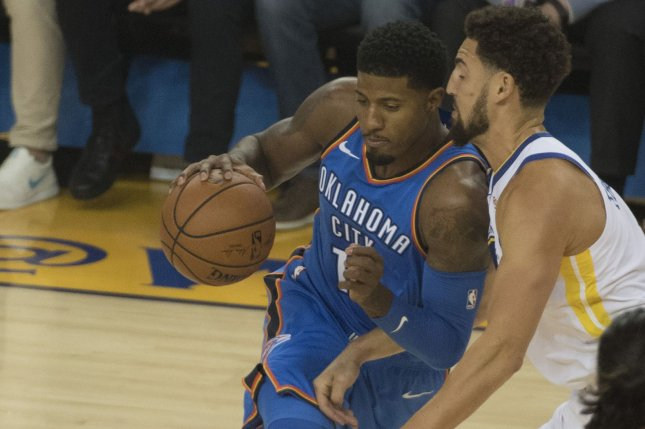 Oklahoma City Thunder forward Paul George (L) will miss the team's game against the Philadelphia 76ers on Thursday night due to shoulder soreness. File Photo by Terry Schmitt/UPI