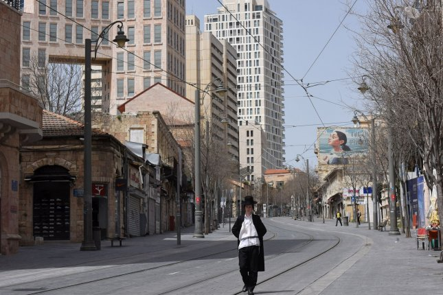 An Ultra-Orthodox Israeli walks on an empty street in Jerusalem, on March 27, 2020.The Israel Defense Force is seeking the rental of hotels to house citizens returning from abroad for Passover, who must self-quarantine for 14 days after their arrival. Photo by Debbie Hill/UPI