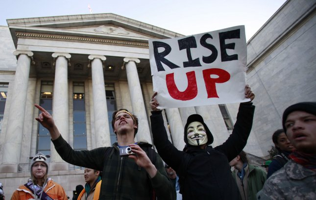 Occupy Congress protesters rally on the steps of the Rayburn House office building on Capitol Hill in Washington on January 17, 2012. UPI/Yuri Gripas.