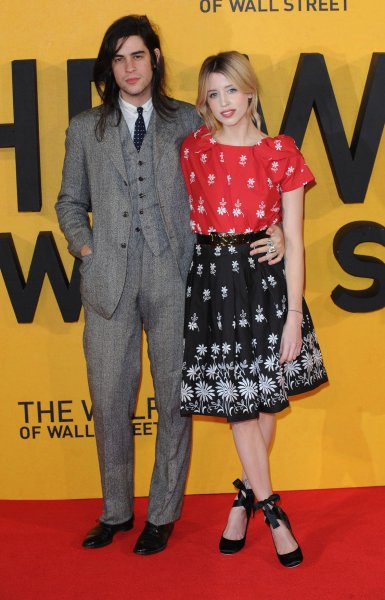 English musician Thomas Cohen and his wife, English journalist, television presenter and model Peaches Geldof attends the UK premiere of 'The Wolf Of Wall Street' at The Odeon Leicester Square in London on January 9, 2014. UPI/Paul Treadway