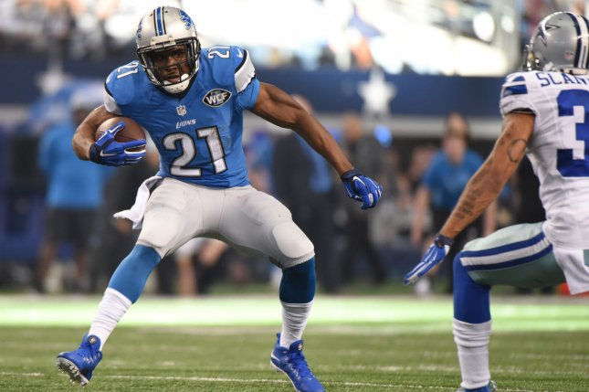 Former Detroit Lions running back Reggie Bush scores on a 18-yard run in the first quarter against the Dallas Cowboys in a NFL Wild Card Game at AT&T Stadium in Arlington, Texas on January 4, 2015. Photo by Ian Halperin/UPI