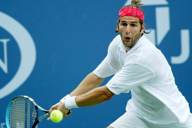 Jerome Golmard (FRA) hits a backhand in his four-set defeat of Tim Henman (GBR) at the US Open in Flushing, New York. File photo by John Angelillo/UPI .
