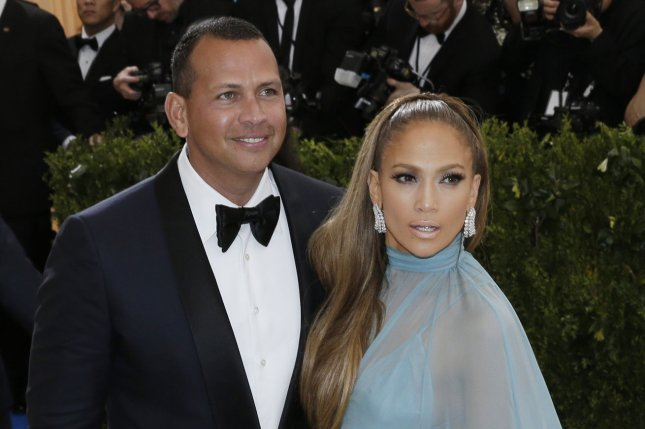 Jennifer Lopez (R) and Alex Rodriguez attend the Costume Institute Benefit at the Metropolitan Museum of Art on May 1. The singer explained in the October/November issue of Hola! USA why Rodriguez is her first good relationship. File Photo by John Angelillo/UPI