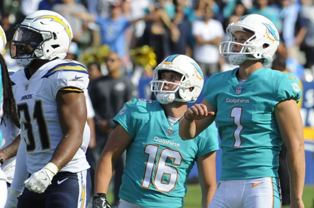 Miami Dolphins kicker Cody Parkey, right, kicks the winning field goal in the second half against the Los Angeles Chargers Sunday at StuHub Center in Carson, Calif. Photo by Lori Shepler/UPI