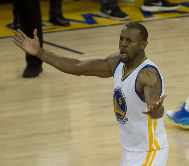e7b16b2460bd Golden State Warriors Andre Iguodala (9) pleads for a foul after having his  arm pushed by Oklahoma City Thunder s Kevin Durant in the second half of  Game 7 ...