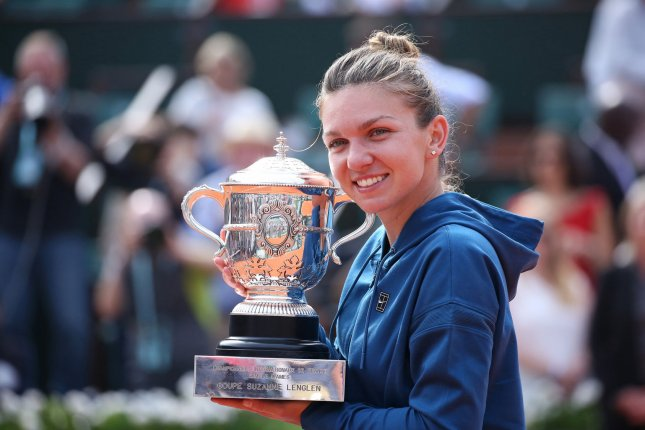 Simona Halep of Romania holds the championship trophy after winning her French Open women's final match against American Sloane Stephens Saturday at Roland Garros in Paris. Photo by David Silpa/UPI