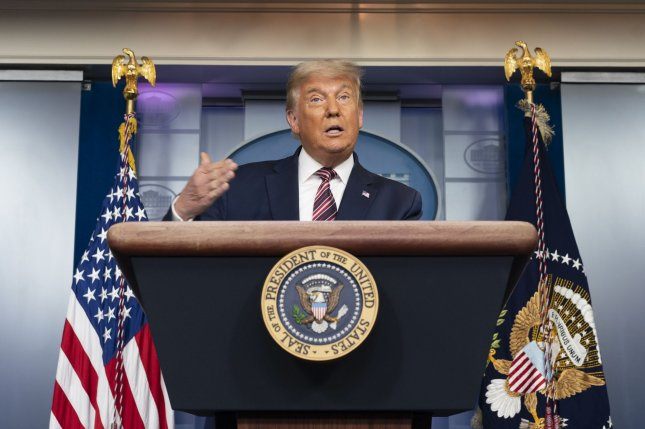 President Donald Trump's campaign initially asked Arizona to review in-person ballots rejected because they were over votes. Photo by Chris Kleponis/UPI