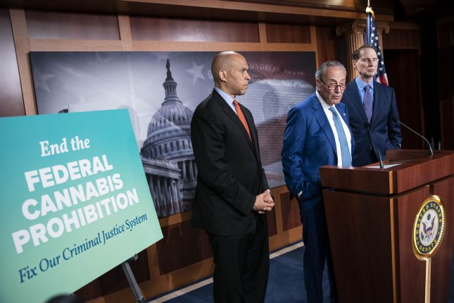 Senate Majority Leader Chuck Schumer, D-N.Y., (C) speaks during a news conference to call for the decriminalize marijuana at the federal level at the U.S. Capitol in Washington, D.C., on Wednesday. Leader Schumer was joined by Senators Cory Booker, D-N.J., (L) and Ron Wyden (D-OR) who have been working in support of the legislation. Photo by Sarah Silbiger/UPI