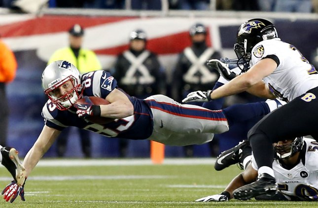 New England Patriots Wes Welker dives for extra yards on a kick off return in the first quarter against the Baltimore Ravens in the AFC Championship Game at Gillette Stadium in Foxborough, Massachusetts on January 20, 2013. UPI/John Angelillo