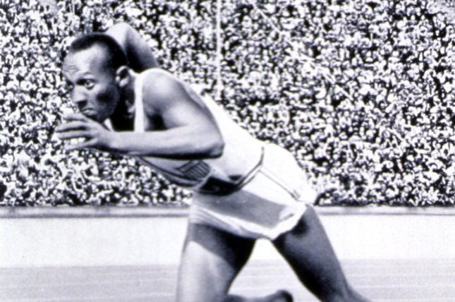 American Olympic athlete, Jesse Owens, runs his historic, record-breaking 200 meter race at the 1936 Olympic Games in Berlin. (File/UPI)
