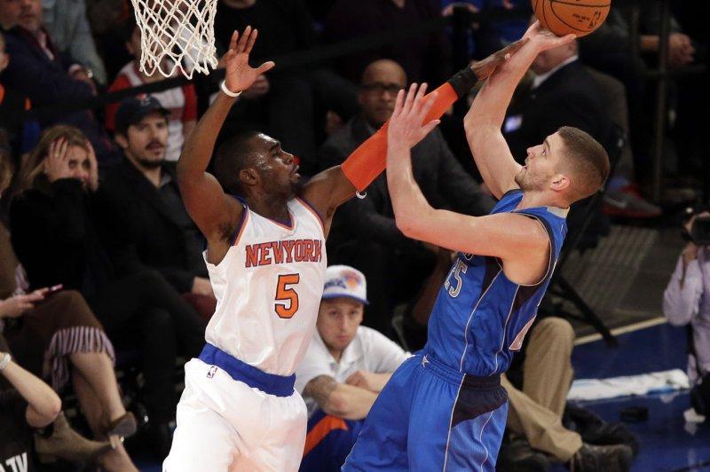 Dallas Mavericks Chandler Parsons scores a basket over New York Knicks Tim Hardaway Jr. in the first half at Madison Square Garden in New York City on December 16, 2014. UPI/John Angelillo