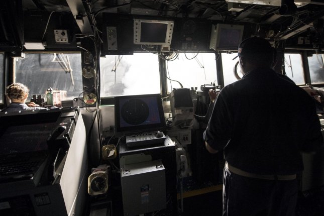Sailors stand watch on the bridge while Tomahawk cruise missiles are launched aboard the guided-missile cruiser USS Philippine Sea (CG 58) in the Arabian Gulf against Islamic State bases in Syria on September 23, 2014. Joint U.S.-Arab airstrikes launched attacks against the terrorist group IS, also called ISIS or ISIL. (UPI/Abe McNatt/U.S. Navy)