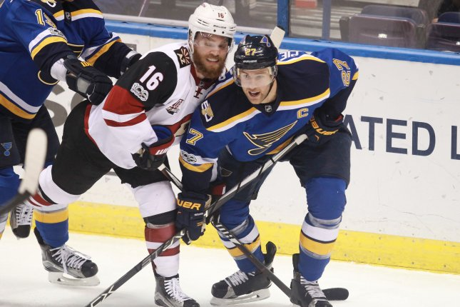 Arizona Coyotes' Max Domi and St. Louis Blues' Alex Pietrangelo tie up during the first period on March 27 at the Scottrade Center in St. Louis, Mo. File photo by Bill Greenblatt/UPI