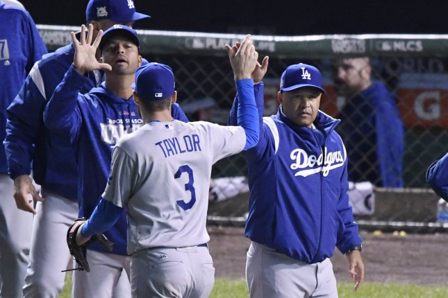 Los Angeles Dodgers manager Dave Roberts (R) congratulates Chris Taylor (3) after their win over the Chicago Cubs in Game 3 of the NLCS Tuesday at Wrigley Field in Chicago. The Dodgers won 6-1 and lead the best of seven series 3-0. Photo by Brian Kersey/UPI