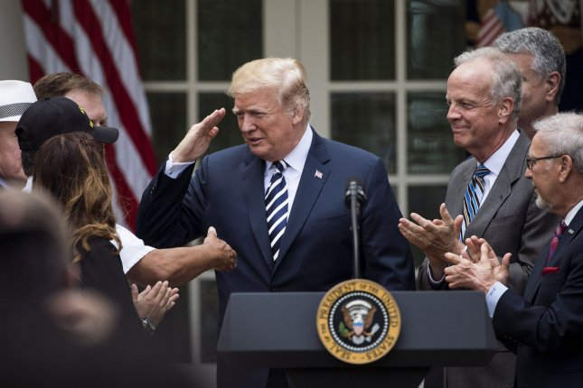 President Donald Trump salutes as he arrives to sign the VA Mission Act of 2018 during a signing ceremony Wednesday in the Rose Garden at the White House. The law expands healthcare to veterans by giving $52 billion to allow them to seek care outside of the VA system. Photo by Kevin Dietsch/UPI