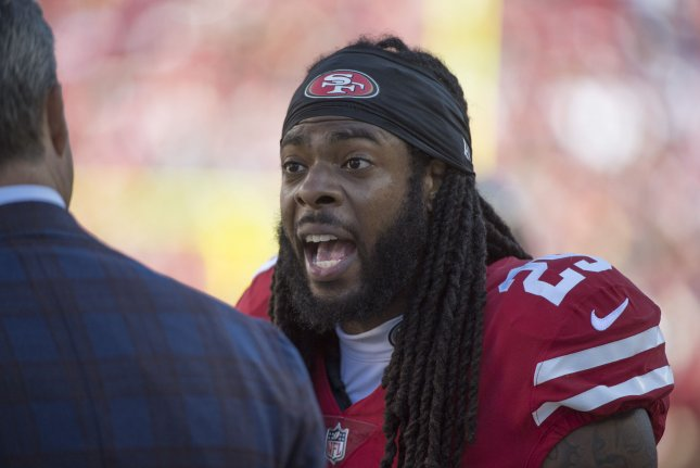 San Francisco 49ers cornerback Richard Sherman (R) talks on the sideline in the fourth quarter against the Detroit Lions on September 16, 2018 at Levi's Stadium in Santa Clara, California. Photo by Terry Schmitt/UPI
