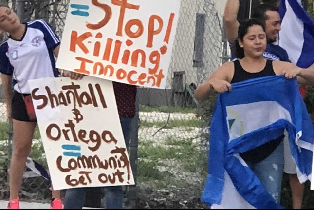 Demonstrators protest the regime of Nicaraguan President Daniel Ortega at a rally in Miami, Florida, on June 1. Photo by Gary I Rothstein/UPI