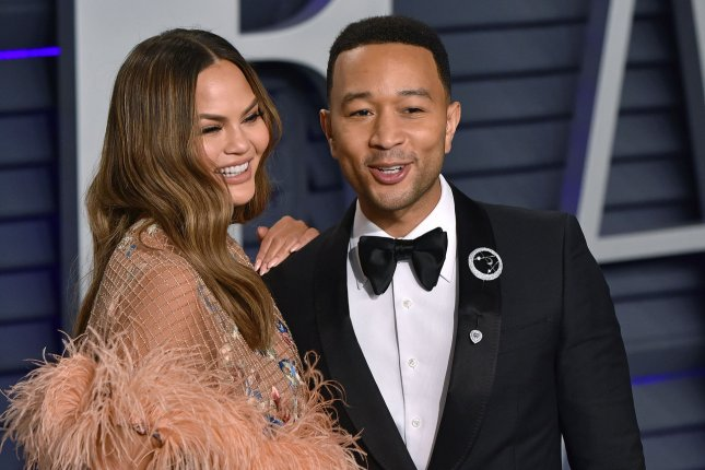 John Legend (R) with his wife Chrissy Teigen. The singer discussed being a Voice coach on Late Night and how he and Adam Levine used to date within the same circles. Photo by Christine Chew/UPI