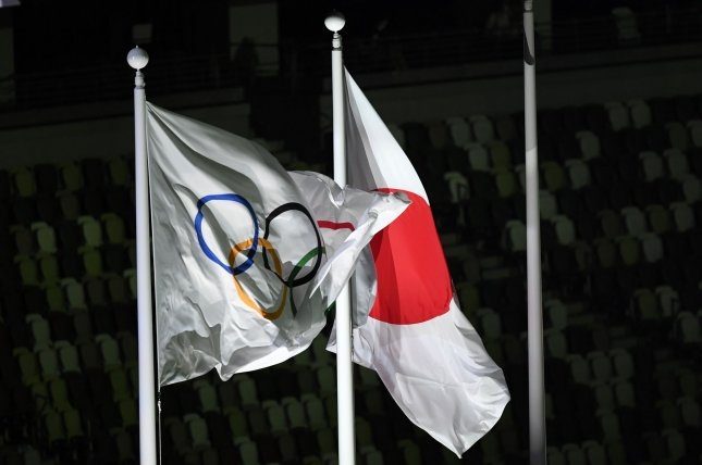 The Japanese and Olympic flags are seen during the closing ceremony at Olympic Stadium on August 8. Photo by Mike Theiler/UPI