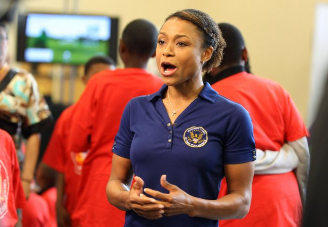 Olympic gymnast Dominique Dawes speaks during the President's Council on Fitness, Sports and Nutrition active video game demonstration event with students from Walker Jones Education Campus in Washington DC on April 30, 2012. UPI/Molly Riley