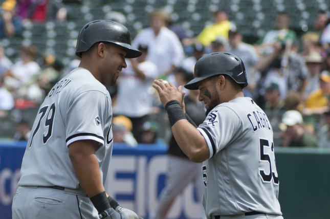 Chicago White Sox's Jose Abreu (L) celebrates with Melky Cabera after a two run home run off Oakland A's Kendall Graveman in the sixth inning at the Coliseum in Oakland, California on April 7, 2016. Cabrera scored ahead of him as the White Sox defeated the A's 6-1. Photo by Terry Schmitt/UPI