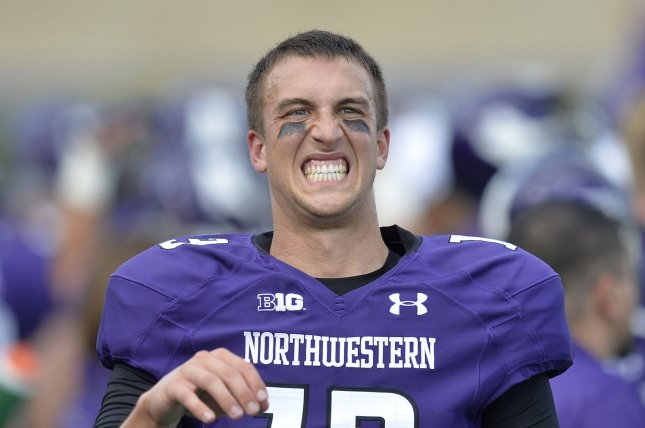 Former Northwestern quarterback Trevor Siemian warms up on the sideline during the second quarter against California at Ryan Field on August 30, 2014 in Evanston, Illinois. UPI/Brian Kersey