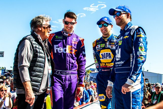 Mario Andretti (left to right), Denny Hamlin, Chase Elliott, and Dale Earnhardt Jr. visit before the Daytona 500 in February 2017. Younger drivers like Elliott and Hamlin are benefitting from recent rules changes. Photo by Edwin Locke/UPI