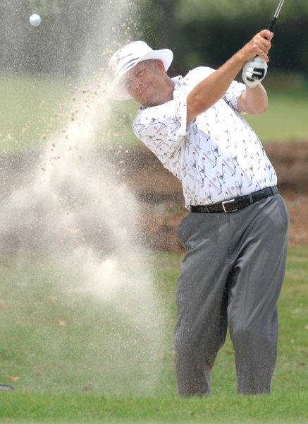 Kirk Triplett blasts from a sand trap at The Players Golf Championship in May. Triplett shot a record 62 in the first round of the U.S. Senior Open on Thursday. Photo by Pat Benic/UPI