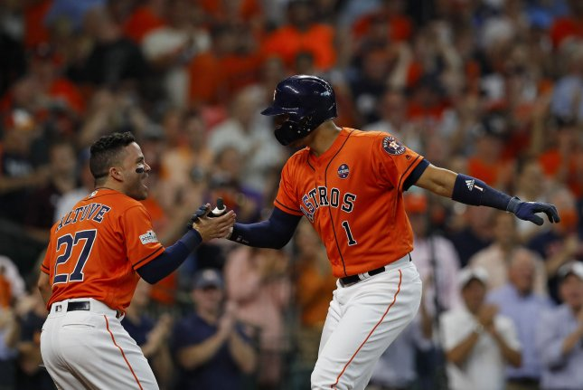 Houston Astros shortstop Carlos Correa (1) celebrates with teammate second baseman Jose Altuve (27) after hitting a two run homer run against the Boston Red Sox in the first inning of game 2 of the ALDS in Houston, Texas on October 6, 2017. Photo by Aaron M. Sprecher/UPI.