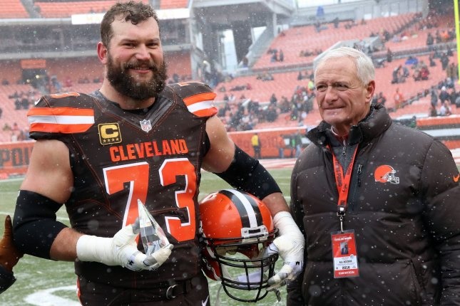 Cleveland Browns tackle Joe Thomas (L) stands with team owner Jimmy Haslam after being named the 2016 Walter Payton Man of the year. File photo by Aaron Josefczyk/UPI