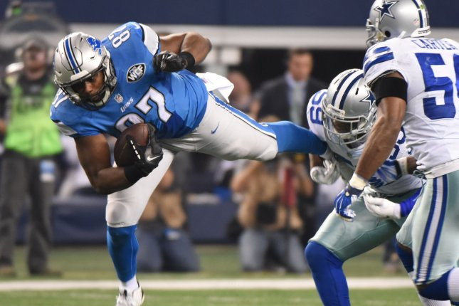 Former Detroit Lions tight end Brandon Pettigrew (87) gets tripped up by ex-Dallas Cowboys linebacker Anthony Hitchens during the second half of an NFL Wild Card Game on January 4, 2015 at AT&T Stadium in Arlington, Texas. File photo by Ian Halperin/UPI