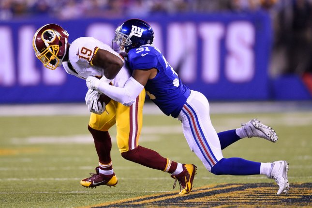 Former Washington Redskins wide receiver Rashad Ross (19) gets tackled by New York Giants defensive back Trevin Wade (31) in 2015 at MetLife Stadium in East Rutherford, N.J. File photo by Rich Kane/UPI