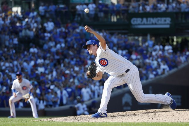 Relief pitcher Brad Wieck had two strikeouts in the ninth inning of the Chicago Cubs' win against the Seattle Mariners Monday in Chicago. Photo by Kamil Krzaczynski/UPI