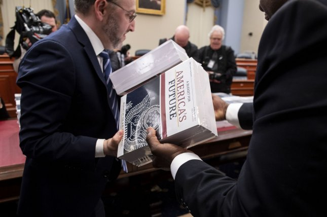 Members of the Government Printing Office unload copies of President Donald Trump's proposed FY2021 budget on Capitol Hill on February 10. Photo by Kevin Dietsch/UPI