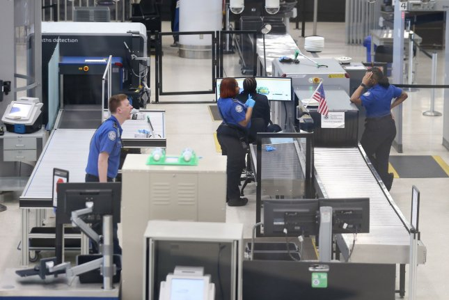 TSA agents talk among themselves as they wait for passengers at St. Louis-Lambert International Airport in St. Louis on in March 2020. On Saturday an agency spokeswoman announced the TSA had screened nearly 2 million passengers -- the highest number since the COVID-19 pandemic began. Photo by Bill Greenblatt/UPI