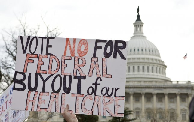 Protesters display signs outside the U.S. Capitol during the Americans for Prosperity and Patients First healthcare rally on Capitol Hill in Washington on December 15, 2009. UPI/Madeline Marshall