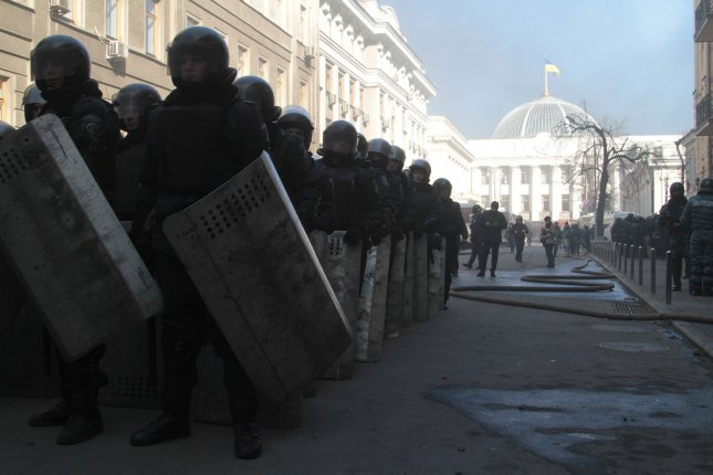 Ukrainian riot police secure the parliament building in Kiev on February 18, 2014. Authorities report at least nine people were killed including two police officers on the worst day of violence in the two-month long protests against the government. UPI/Sergey Starostenko