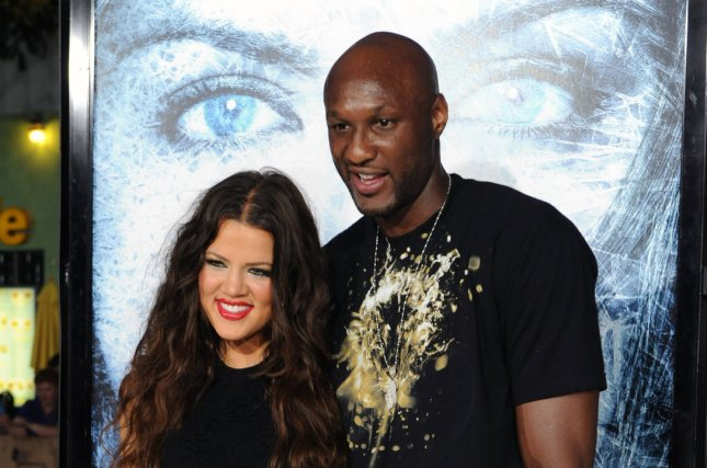 Khloe Kardashian (L) with husband Lamar Odom at the Los Angeles premiere of 'Whiteout' on September 9, 2009. The couple signed to finalize their divorce last week. File photo by Jim Ruymen/UPI