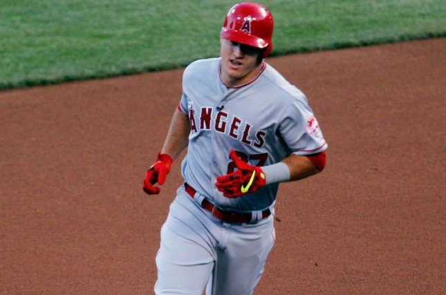 Los Angeles Angels' Mike Trout (27) rounds second base. Photo by John Sommers II/UPI