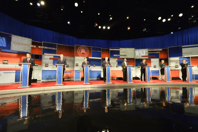 Republican presidential hopefuls, from left, Ohio Gov. John Kasich, former Florida Gov. Jeb Bush, Florida Sen. Marco Rubio, Donald Trump, Dr. Ben Carson, Texas Sen. Ted Cruz, former HP CEO Carly Fiorina, and Kentucky Sen. Rand Paul take their podiums Tuesday for the fourth Republican debate at the Milwaukee Theater in Milwaukee, Wis. Twelve candidates are debating each other in two difference segments. Photo by Brian Kersey/UPI