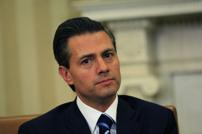 Mexican President Enrique Peña Nieto on Thursday was called on to resign by a protest of thousands a day before the country began celebrations for its Independence Day. Peña Nieto's approval rating has recently sunk to 23 percent. File Photo by Dennis Brack/Pool/UPI