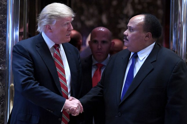 President-Elect Donald Trump shakes hands with Martin Luther King III as they exit the elevators in the lobby of the Trump Tower in New York City on Monday. Trump and King met on Martin Luther King Jr. Day to discuss race relations and voting rights, King told reporters after the meeting. Pool photo by Anthony Behar/UPI