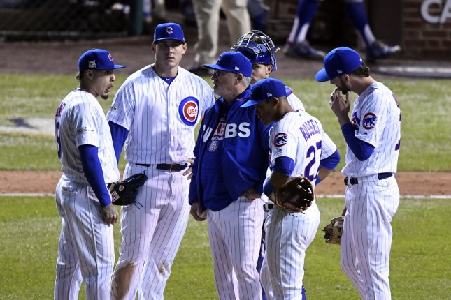 Chicago Cubs manager Joe Maddon (C) talks to his team during a pitching change in the eighth inning of game 3 of the NLCS against the Los Angeles Dodgers at Wrigley Field on October 17, 2017 in Chicago. Photo by Brian Kersey/UPI