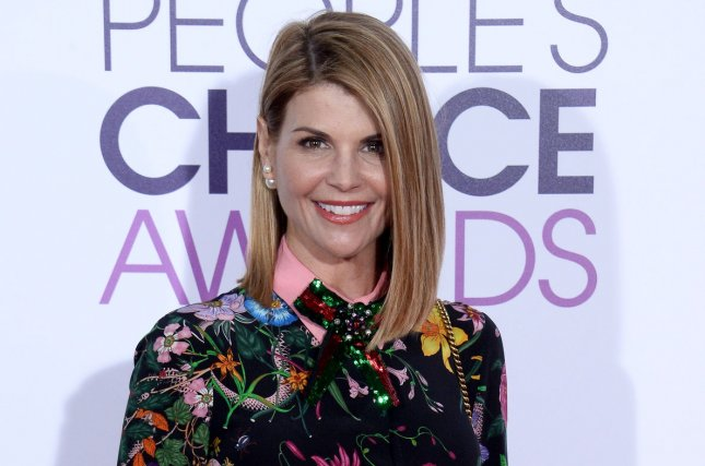 Lori Loughlin shared a picture with Billy, John Stamos' son with Caitlin McHugh, on Wednesday. File Photo by Jim Ruymen/UPI