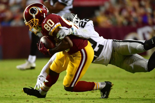 Washington Redskins wide receiver Jamison Crowder (80) brings in a first down against Oakland Raiders cornerback Gareon Conley in the second quarter on September 24, 2017 at FedEx Field in Landover, Maryland. Photo by Kevin Dietsch/UPI