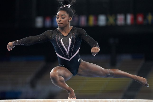 Team USA gymnast Simone Biles practices her routine on the balance beam for the 2020 Summer Games on Thursday in Tokyo. Photo by Richard Ellis/UPI