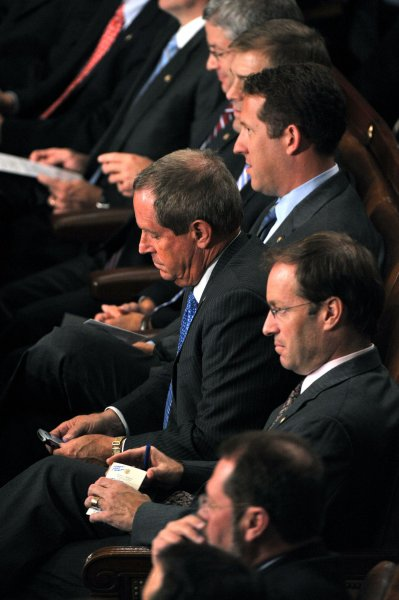 Rep. Joe Wilson (R-SC) checks his phone after yelling out during President Barack Obama's speech on healthcare reform before a joint session of Congress at the U.S. Capitol Building in Washington on September 9, 2009. UPI/Kevin Dietsch