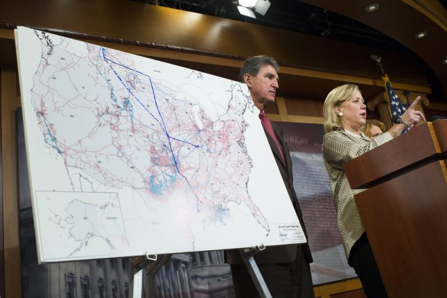 Sen. Mary Landrieu, D-LA and Sen. Joe Manchin, D-W.V., speaks alongside the map of the Keystone XL pipeline at a press conference after the Senate failed to get the 60 votes needed to approve the construction of the Keystone XL pipeline, in Washington, D.C. on November 18, 2014. The Senate voted 59-41. UPI/Kevin Dietsch